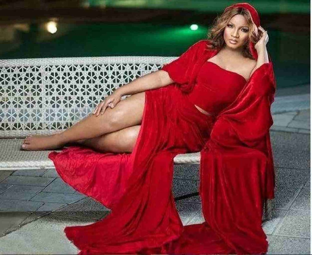 Image of Omotola Jalade in a red dress
