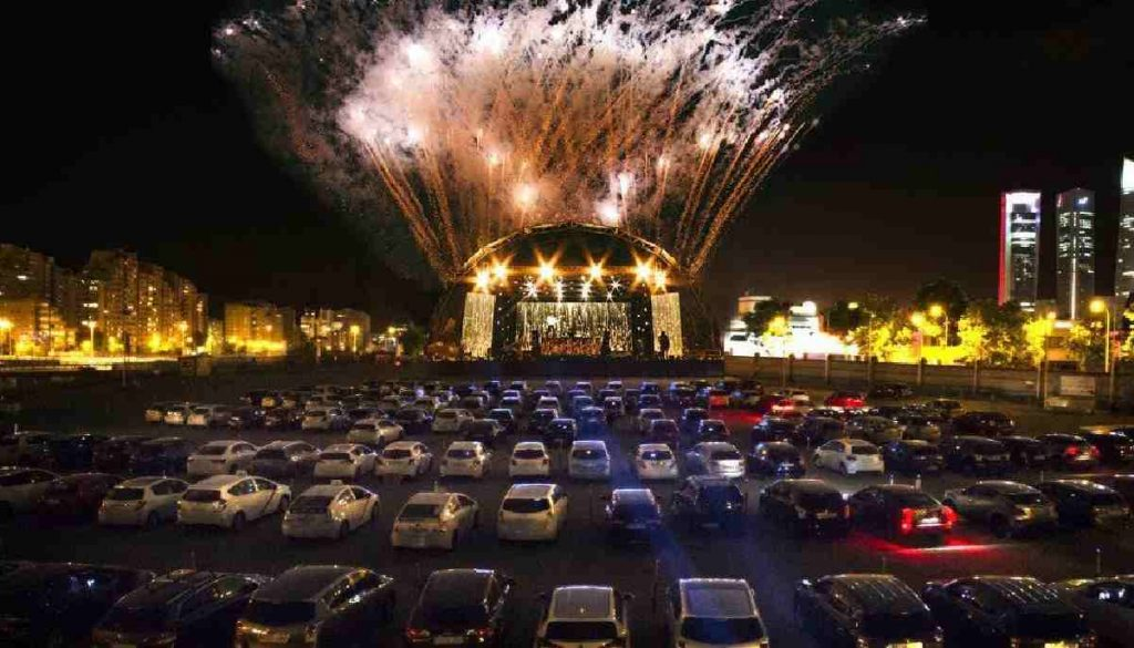 Image of cars park outside a concert in the UK